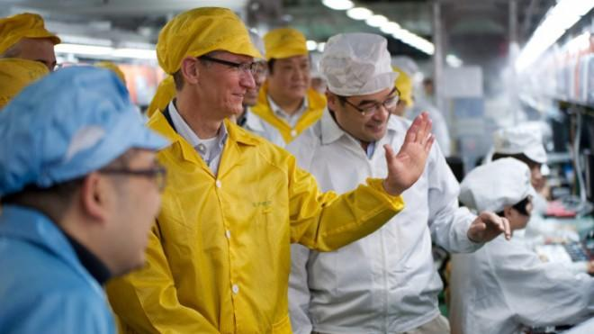 Apple CEO Tim Cook visits an iPhone production line at China's Foxconn in 2012.