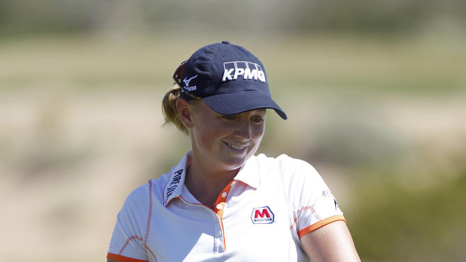 Stacy Lewis reacts after missing a putt for birdie on the fourth green during the first round of the Founders Cup golf tournament on Thursday, March 14, 2013, in Scottsdale, Ariz. (AP Photo/Paul Connors)