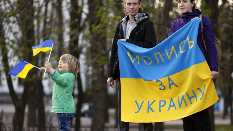 People attend a pro-Ukrainian rally in Luhansk