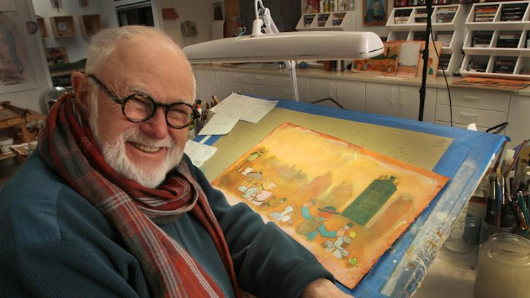 "In this photo taken Sunday Dec. 1, 2013 children's author and illustrator Tomie dePaola poses in his studio with artwork from his new book ""Jack"" in New London, N.H. As he nears his 80th birthday, dePaola, is still working on new books for children. (AP Photo/Jim Cole)"