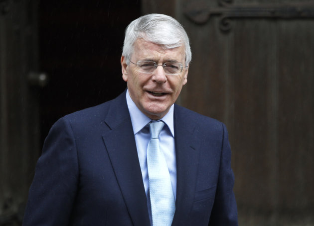 Former British Prime Minister John Major poses for photographers as he arrives to give evidence to the Leveson inquiry at the Royal Courts of Justice in central London, Tuesday, June 12, 2012. The Leveson inquiry is Britain's media ethics probe that was set up in the wake of the scandal over phone hacking at Rupert Murdoch's News of the World, which was shut in July 2011 after it became clear that the tabloid had systematically broken the law. (AP Photo/Lefteris Pitarakis)