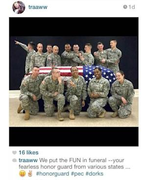 This photo posted to the instagram account belonging to Spc. Terry Harrison shows a dozen soldiers clowning around a casket draped in a flag at a National Guard training facility in Arkansas. The Wisconsin National Guard on Tuesday, Feb. 18, 2014 announced that it had suspended Harrison from honor guard duties after she apparently posted the photo. (AP Photo)