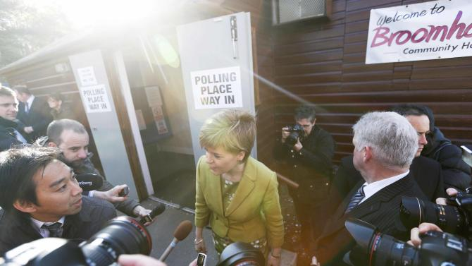 Nicola Sturgeon, the leader of the Scottish National Party, leaves after voting in Broomhouse, Scotland