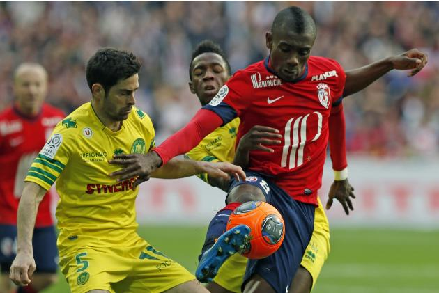 Lille's Kalou fights for the ball with Nantes' Toure during their French Ligue 1 match in Villeneuve d'Ascq