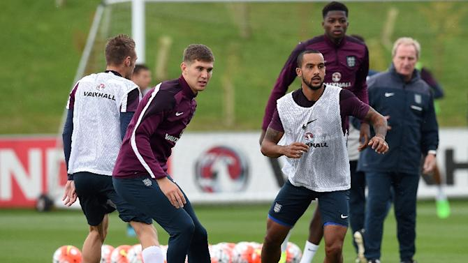 England's John Stones (2nd L) and Theo Walcott (3rd R) take part in a team training session at St George's Park, Burton-upon-Trent, central England, on September 2, 2015