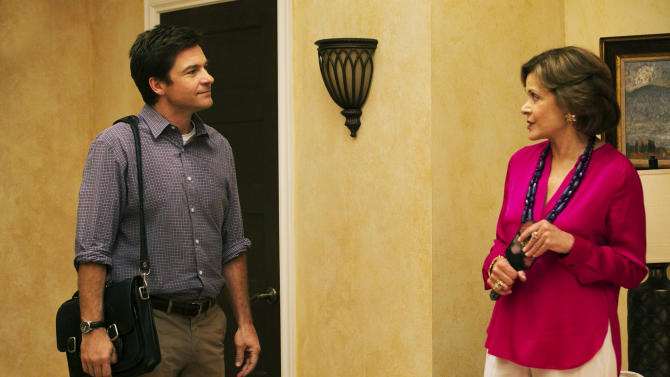 """This undated publicity photo provided by Netflix shows Jason Bateman, left, and Jessica Walter in a scene from the new season of """"Arrested Development"""" on Netflix. Even Walter, an Emmy-winning character actress, is surprised to find herself at a new professional peak, thanks to the Netflix revival of her sitcom """"Arrested Development"""" as well as the continued success of the animated FX cult favorite, """"Archer."""" The new season for """"Arrested Development"""" began Sunday, May 26, 2013. (AP Photo/Netflix, Mike Yarish)"""