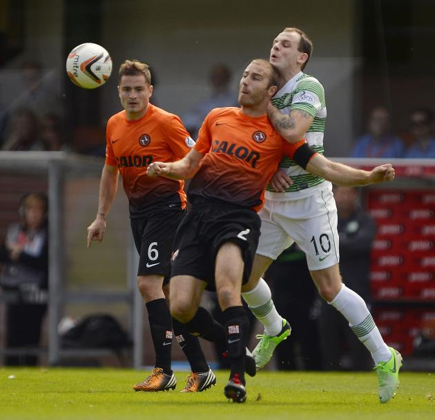 Celtic's Stokes challenges Dundee United's Dillon during their Scottish Premier League soccer match in Dundee