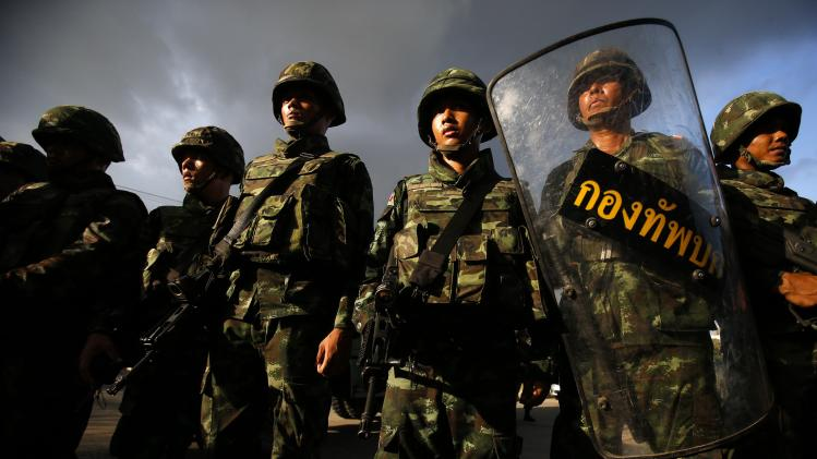 File photo of Thai soldiers standing guard during a coup, at the Army Club where Thailand's army chief held a meeting with all rival factions in central Bangkok