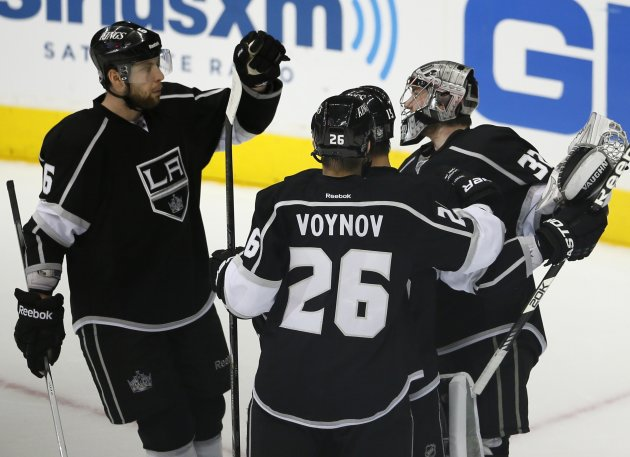 Kings goalie Jonathan Quick is congratulated by teammates after a win over the San Jose Sharks following Game 5