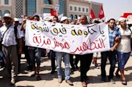 "<p>Demonstrators demand the ""cleansing"" of Tunisia at the Kasbah, the site of government headquarters, in Tunis on Friday.</p>"