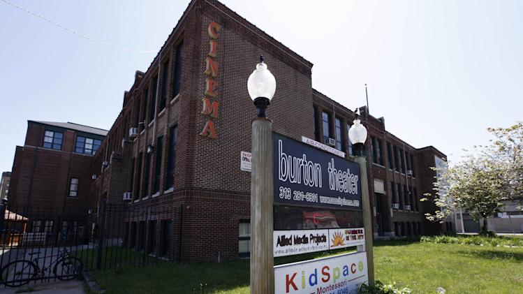 The former Burton International school, shown Wed. June 5, 2013 was among dozens of Detroit schools forced to close in recent years as the public school system sank deep into debt and parents sought better education options for their children. A number of former Detroit Public Schools have found new life in the private sector, including as a movie theater, a church and recording studio. (AP Photo/Paul Sancya)