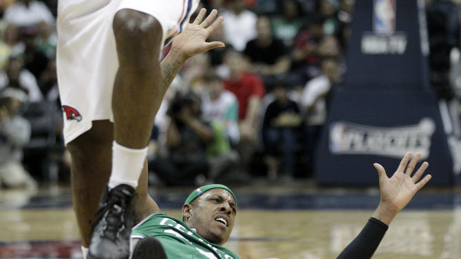 Boston Celtics' Paul Pierce looks for a call from an official after colliding with Atlanta Hawks' Ivan Johnson, left, during the first quarter of Game 1 of an opening-round NBA basketball playoff series, Sunday, April 29, 2012, in Atlanta. (AP Photo/David Goldman)