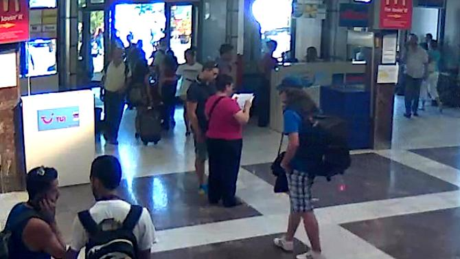 RETRANSMISSION FOR ALTERNATIVE CROP  This image taken from CCTV provided by the Bulgarian Interior Ministry Thursday July 19, 2012 who claim it shows the unidentified bomber, center, with long hair and wearing a baseball cap, at Burgas Airport in Burgas, Bulgaria on Wednesday, July 18, 2012. The brazen daytime bombing that killed seven people and injured dozens on a bus full of Israeli tourists was most likely a suicide attack, Bulgarian officials said Thursday. Israel stood by its claim that Iranian-backed Hezbollah was responsible and vowed to hit back. The identity of the suspected bomber was still unknown but a Michigan driving license that he carried was a fake, Bulgarian Prime Minister Boiko Borisov said. (AP Photo/Bulgarian Interior Ministry)