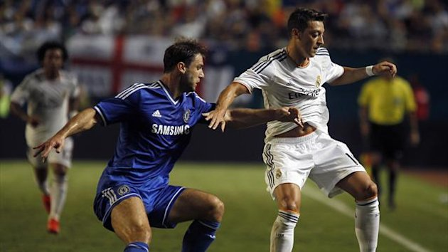 Chelsea's Branislav Ivanovic (L) and Real Madrid's Mesut Ozil fight for the ball during their Guinness International Champions Cup final soccer match in Miami Gardens, Florida August 7, 2013 (Reuters)