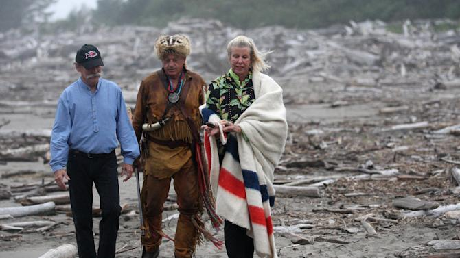 William Clark's descendants Peyton 'Bud' Clark, left, and Carlota 'Lotsie' Holton, right, walks with Lewis and Clark historian Roger Wendlick Thursday, Sept. 22, 2011, at Cape Disappointment State Park, near Ilwaco, Wash. Back in 1806, explorers Meriwether Lewis and William Clark stole a canoe from native Americans living on the Pacific Coast. More than 200 years later, Clark's descendants are making amends to the Indian's descendants by having a 36-foot replica built for them. (AP Photo/Rick Bowmer)