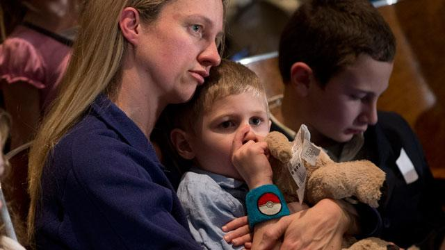 Tears, Resilience at Memorial Service