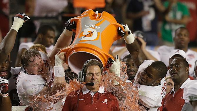 Alabama head coach Nick Saban is dunked with Gatorade in the final seconds of the BCS National Championship college football game against Notre Dame Monday, Jan. 7, 2013, in Miami. Alabama won 42-14. (AP Photo/Wilfredo Lee)