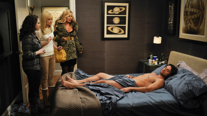 """In this image released by CBS, from left, Kat Dennings, Beth Behrs and Jennifer Coolidge are shown in a scene from """"2 Broke Girls,"""" scheduled to air Monday, Feb. 6 at 8:30 p.m. on CBS. As CBS' Monday night comedies are pushing the barriers with risque jokes, the network and producers of the comedies strongly defend their work and point to the shows' success as evidence they are working for viewers. """"Two and a Half Men"""" is TV's favorite comedy, """"How I Met Your Mother"""" has its best ratings ever in its seventh year and """"2 Broke Girls"""" is a breakout freshman hit. (AP Photo/CBS, Darren Michales)"""