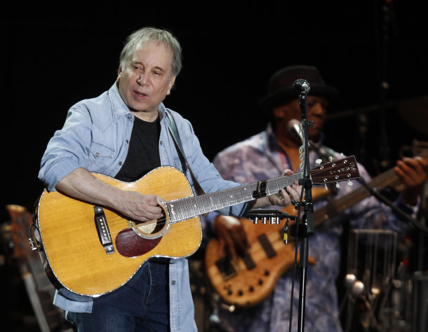 In this July 17, 2011 photo, singer and songwriter Paul Simon performs during a concert at the Arena Civica in Milan, Italy. Paul Simon probably never had a vocal partner quite like Bobby McFerrin, who coaxed him onstage for an impromptu performance of a Simon and Garfunkel hit _ the highlight of opening night of Jazz at Lincoln Center&#39;s 25th anniversary season, Friday, Sept. 14, 2012 in New York. (AP Photo/Luca Bruno)