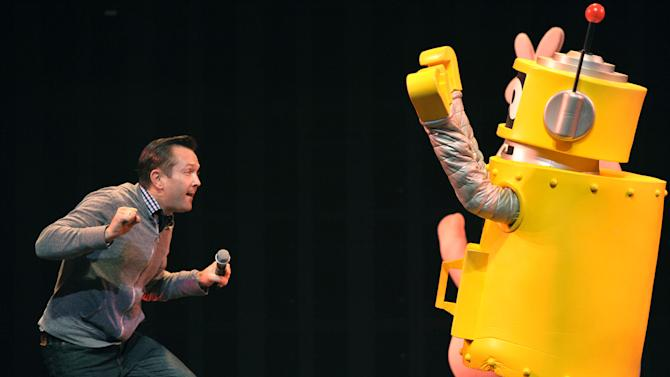 IMAGE DISTRIBUTED FOR GABBA CA DABRA - Thomas Lennon, left, and Plex appear on stage at Yo Gabba Gabba! Live!: Get The Sillies Out! 50+ city tour kick-off performance on Thanksgiving weekend at Nokia Theatre L.A. Live on Friday Nov. 23, 2012 in Los Angeles. (Photo by John Shearer/Invision for GabbaCaDabra, LLC./AP Images)