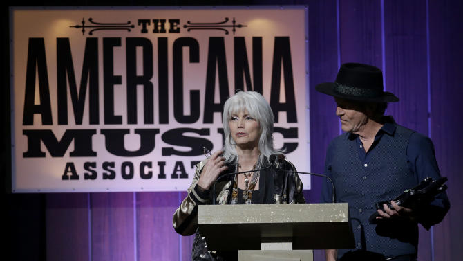 Emmylou Harris and Rodney Crowell accept the award for duo/group of the year during the Americana Honors and Awards show on Wednesday, Sept. 18, 2013, in Nashville, Tenn. (AP Photo/Mark Humphrey)
