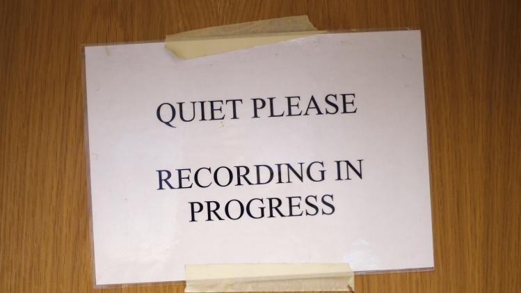 "A sign reminding visitors to remain quiet is taped to a door in the sound room during a live broadcast of the opera ""Parsifal"" from the Royal Opera House in London"
