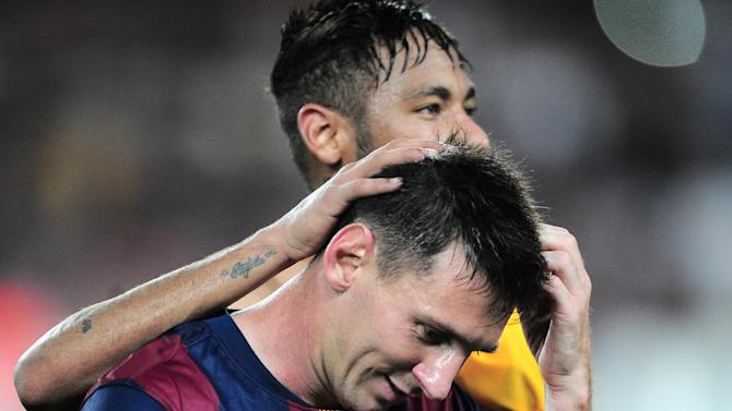 Barcelona's Lionel Messi, front and Neymar leave the field at the end of the Champions League Group F soccer match between Barcelona and Apoel at the Camp Nou stadium in Barcelona, Spain, Wednesday, Sept. 17, 2014