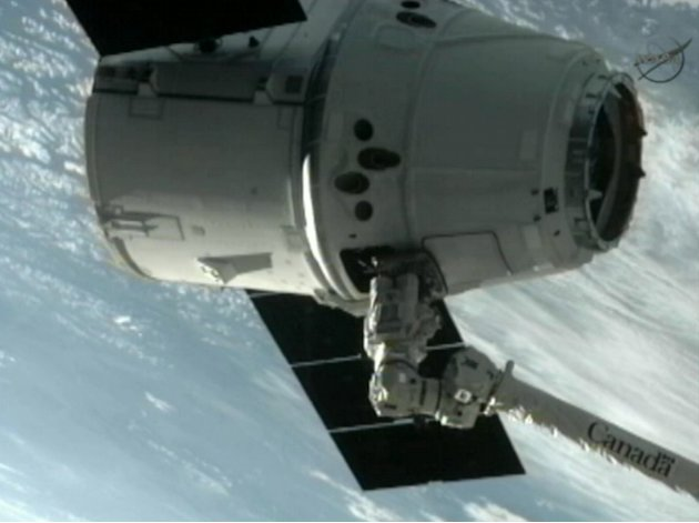 This image provided by NASA-TV shows the SpaceX Dragon commercial cargo craft after Dragon was grappled by the Canadarm2 robotic arm and connected to the International Space Station, Friday, May 25, 2