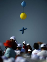 A cross hangs from balloons as youth wait for the arrival of Pope Benedict XVI in the Lebanese mountain village of Bkerke