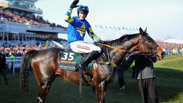 Ryan Mania on Auroras Encore celebrates after winning the Grand National horse race at Aintree Racecourse in Liverpool, north-west England, on April 6, 2013 (AFP)