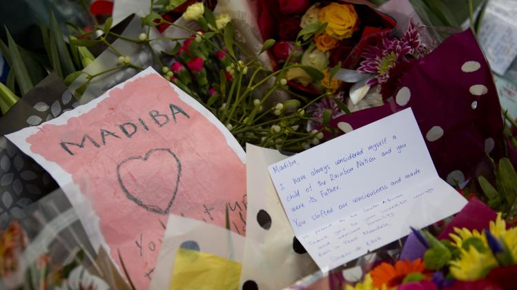 Floral tributes are left for former South African President Nelson Mandela at the South African High Commission in London