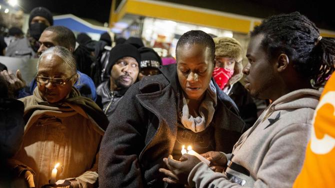 Toni Martin, mother of Antonio Martin, how was fatally shot, attends a prayer vigil for her son, in Berkeley, Missouri
