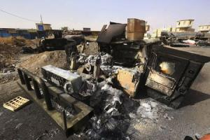 Burnt vehicles belonging to Iraqi security forces are pictured at a checkpoint in east Mosul, one day after radical Sunni Muslim insurgents seized control of the city