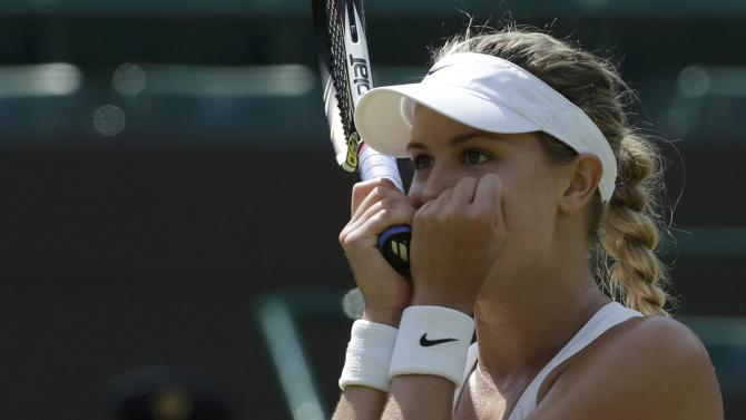 Eugenie Bouchard of Canada reacts after defeating Angelique Kerber of Germany in their women's singles quarter-final tennis match at the Wimbledon Tennis Championships, in London