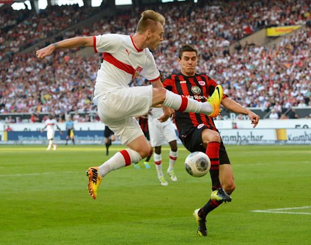 Stuttgart's Alexandru Maxim, left, challenges for the ball with Frankfurt's Johannes Flum during the German Bundesliga soccer  match between VfB Stuttgart and Eintracht Frankfurt at Mercedes-Benz Aren