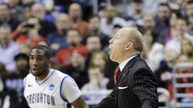 Cincinnati head coach Mick Cronin yells to his team during the first half of a second-round game against Creighton during the NCAA college basketball tournament, Friday, March 22, 2013, in Philadelphia. (AP Photo/Matt Slocum)