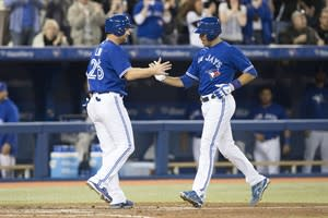 Toronto Blue Jays catcher J.P. Arencibia, right, celebrates at home plate with DH Adam Lind after hitting a two run homerun against the Boston Red Sox during fourth inning AL baseball action in Toronto on Saturday, April 6, 2013. THE CANADIAN PRESS/Chris Young