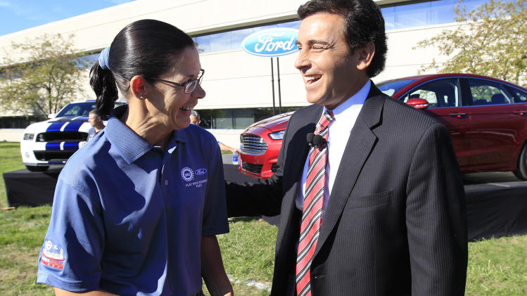 Mark Fields, Ford president of the Americas, talks with Susan E. Spaulding outside the Flat Rock Assembly in Flat Rock, Mich., Monday, Sept. 10, 2012. The plant, formerly known as AutoAlliance International will continue to produce the Mustang and add the Fusion next year. Flat Rock Assembly will be the U.S. producer of the Fusion, employing 2,900 workers on both vehicle lines. (AP Photo/Carlos Osorio)