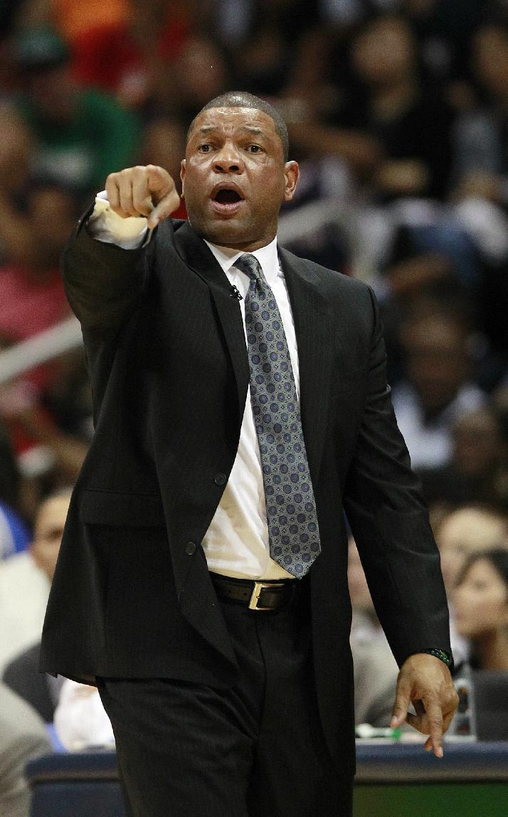 Boston Celtics head coach Doc Rivers directs his team against the Atlanta Hawks in the first half of Game 5 of an NBA first-round playoff series basketball game Tuesday, May 8, 2012, in Atlanta. (AP Photo/John Bazemore)