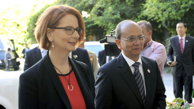President of Myanmar Thein Sein, right, meets with Australian Prime Minister Julia Gillard at Parliament House in Canberra, Australia, Monday, March 18, 2013. Thein is on a three day visit to Australia.  (AP Photo/Alan Porritt, Pool)