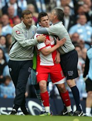 Joey Barton, centre, was handed a 12-game suspension