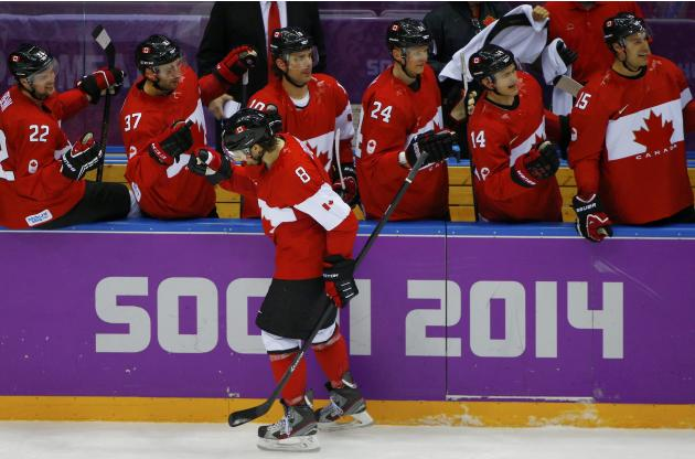 Canada's doughty celebrates his goal against finland with teammates on