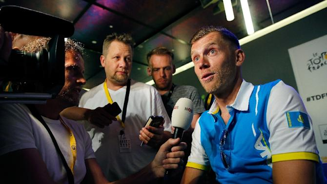 Dutch rider Lars Boom of the Astana ProTeam Racing Team speaks during a press conference on July 3, 2015 in Utrecht, Netherlands, on the eve of the start of the 102nd edition of the Tour de France cycling race