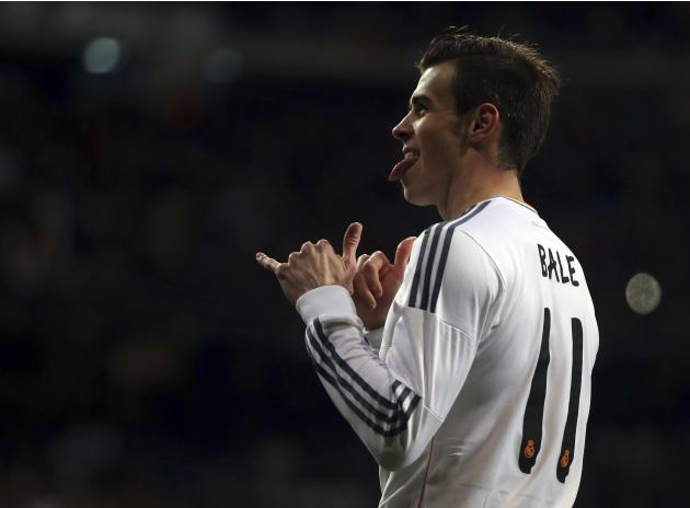 Real Madrid's Bale celebrates after scoring a goal against Villarreal during their Spanish first division soccer match in Madrid