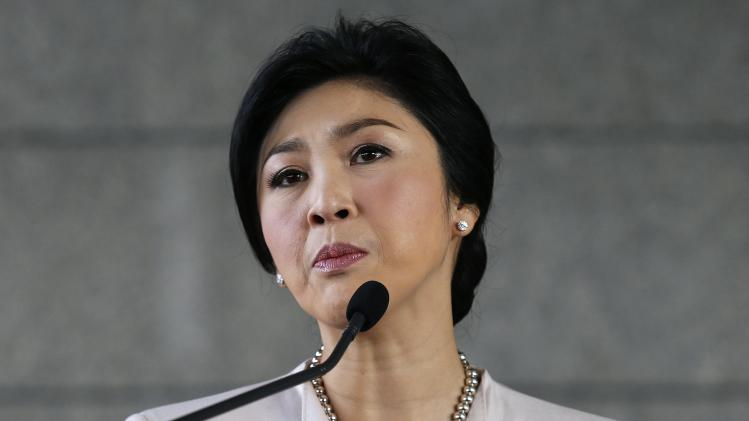 Thai PM Yingluck faces the media during a news conference in Bangkok