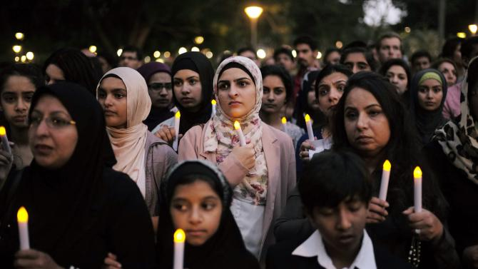 Members of Sydney's Islamic community hold a candlelight vigil for the victims of the Peshawar School attack