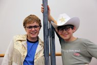 "In this Oct. 26, 2012, photo, Joe West, left, and Johnny Rabe pose in front of one of the props from ""A Christmas Story, the Musical"" in New York. Both 12-year-old boys are making their Broadway debuts playing Ralphie in the stage adaptation of the cult 1983 film. (AP Photo/Mark Kennedy)"