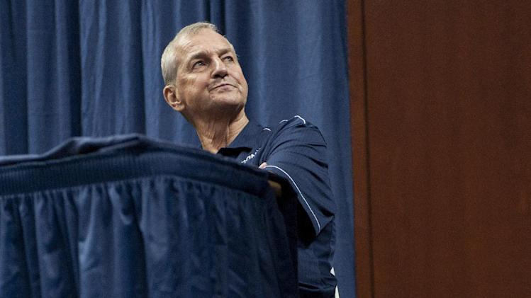 Connecticut head coach Jim Calhoun sits during a news conference in Storrs, Conn., Thursday, Sept. 13, 2012. Calhoun, who built Connecticut into a basketball power and coached the Huskies to three national titles, announced his retirement Thursday. He fractured his hip last month and needs crutches to help him walk. (AP Photo/Jessica Hill)