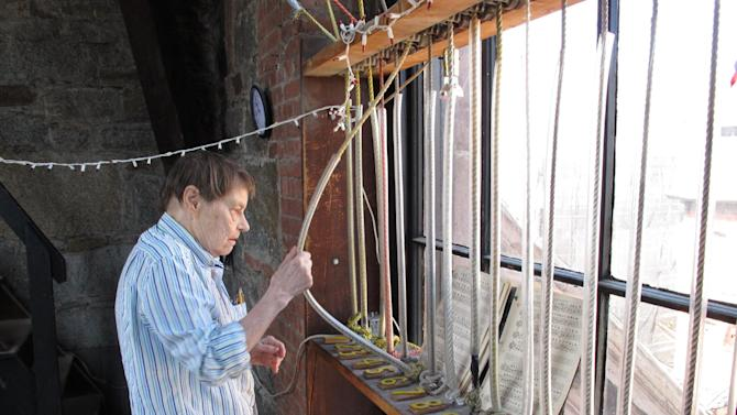 Mary O'Kane, 85, tugs at the carillon ropes in the bell tower of Arlington Street Church in Boston on Thursday, April 18, 2013. The church is just a couple of blocks from the Boston Marathon bombing sites, and she played patriotic tunes to inspire the heartsick. (AP Photo/Allen Breed)