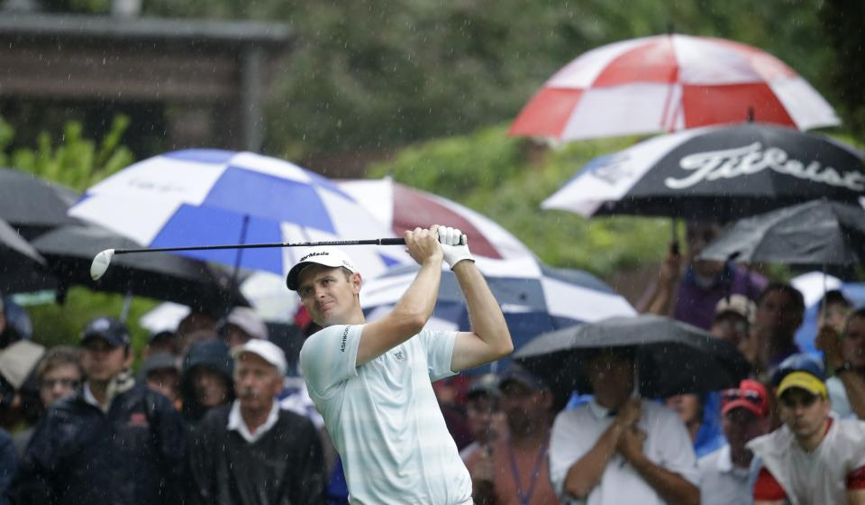 Justin Rose, of England, watches his tee shot on the 10th hole during the second round of the PGA Championship golf tournament at Oak Hill Country Club, Friday, Aug. 9, 2013, in Pittsford, N.Y. (AP Photo/Charlie Neibergall)